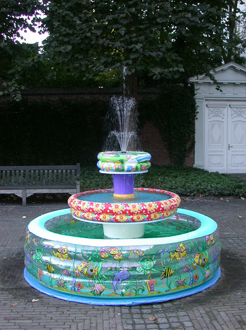 Paddling Pool Fountain, 2003, inflatable paddling pools, buckets, water pump, 3-head spray head, PVC, wood, tarp, glue, paint.