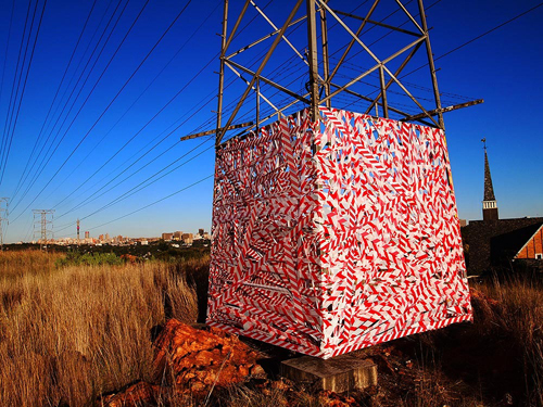 »city cage«, medium: barrier tape (South Africa)
